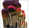 Makeup brushes dusted with colour